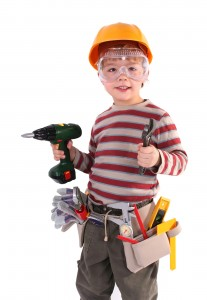 Young Builder with Power Tool Safety Equipment